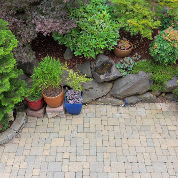 [Image: Adding a hardscape is a great way to enhance the look and functionality of your lawn or yard.]